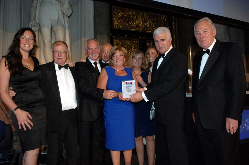 The John Sutch team with Max Steinberg and Peter Sissons, Broadcaster. From L to R: Hayley Sutch-Ware, Mike Fitton, John Sutch, Jimmy Goulbourne, Elaine Sutch, Lorna Renton, Andrea Lowrie, Max Steinberg, Peter Sissons.