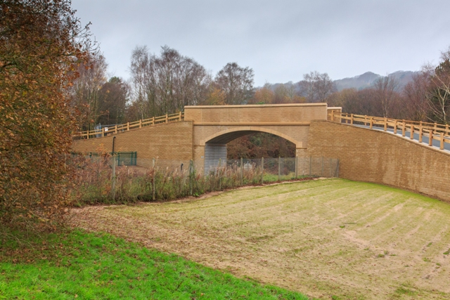 The bridge replaced a level-crossing to improve safety for users of the golf course.